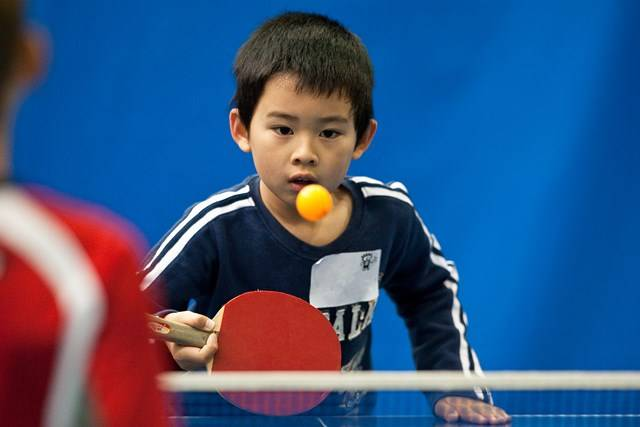 Sports Halls - Child Playing Table Tennis - Photography by Paul K Robbins
